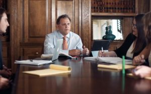 personal injury attorney derek hall meeting with clients